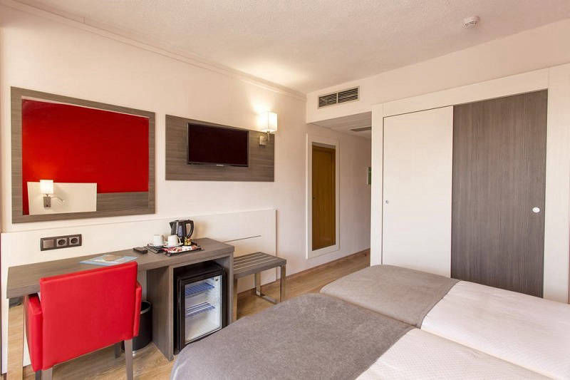 MedPlaya 3 Star Hotel Riudor Benidorm - club room with safe, fridge, large TV and extras.