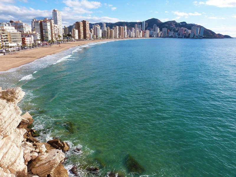 Playa Levante View Across The Bay, Benidorm Spain.
