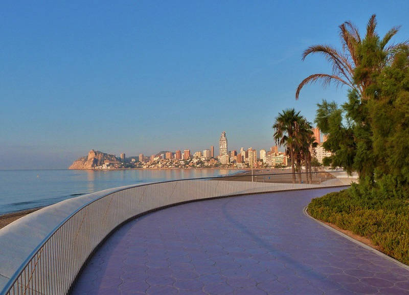 Promenade along the beach on the Poniente Playa in Benidorm Spain.