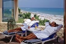 Relax on the Solarium at the Hotel Sidi San Juan and enjoy views of the beach and Mediterranean